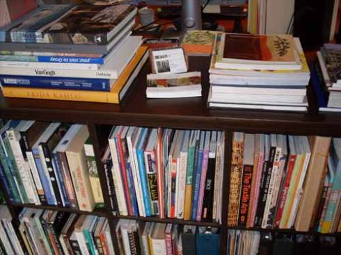 Kristin's beautiful book collection, including my first one in the upper right corner!